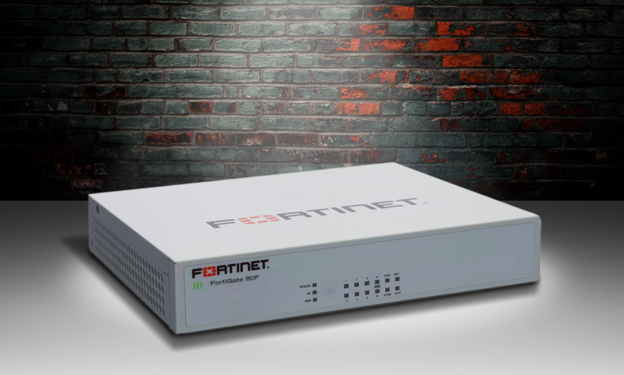 Fortinet FG-80F firewall appliance spotlit on a stage.